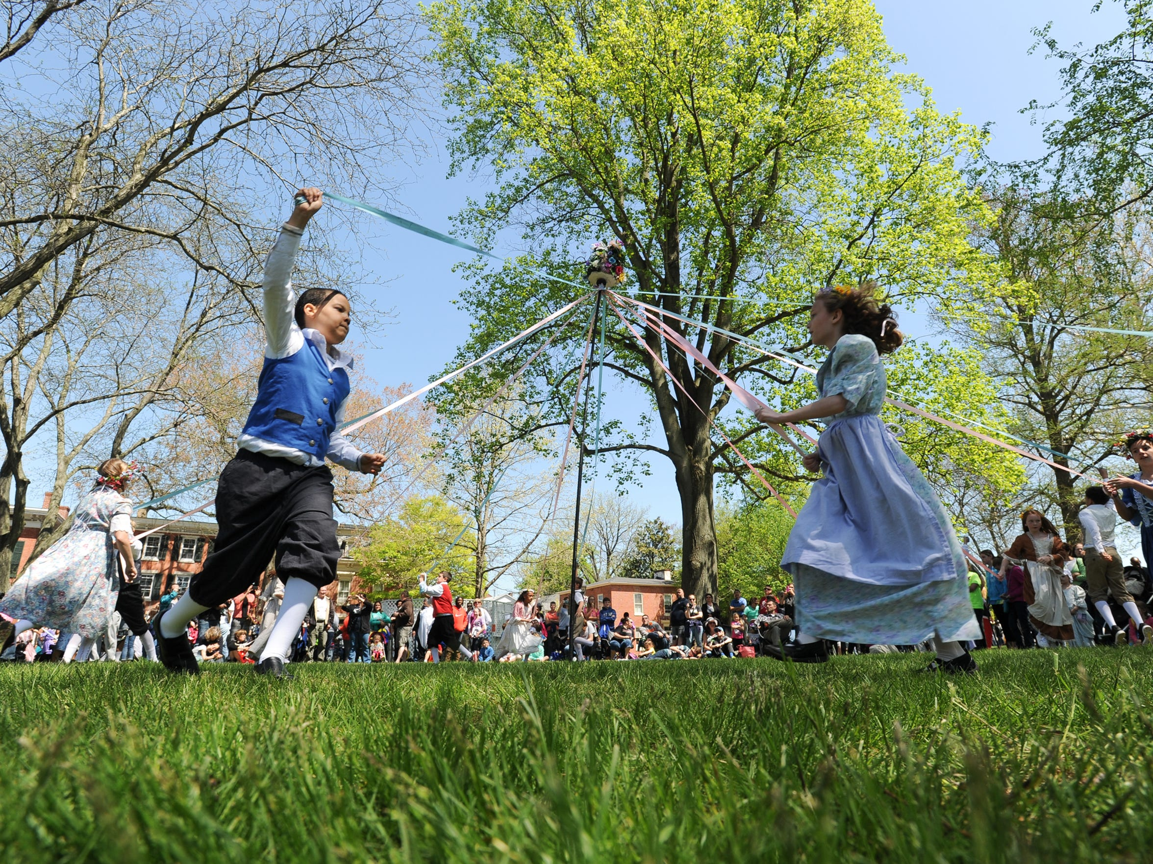 Students from Major George S. Welch Elementary perform the maypole dance at the 81st Dover Days Festival n 2015.