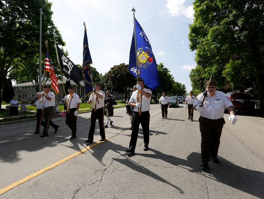 The 2016 Memorial Day parade heads down Main Street