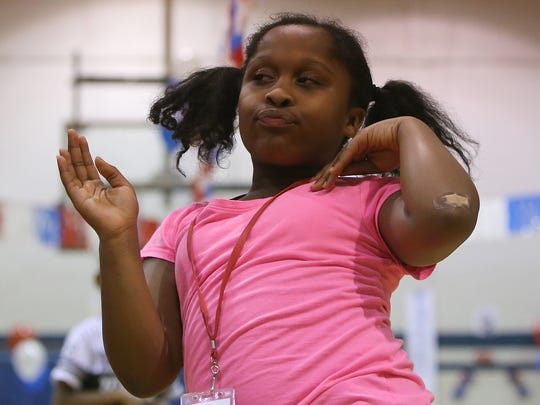 Allie Carney dances Friday during Westwood Day Camp's kickoff bash.