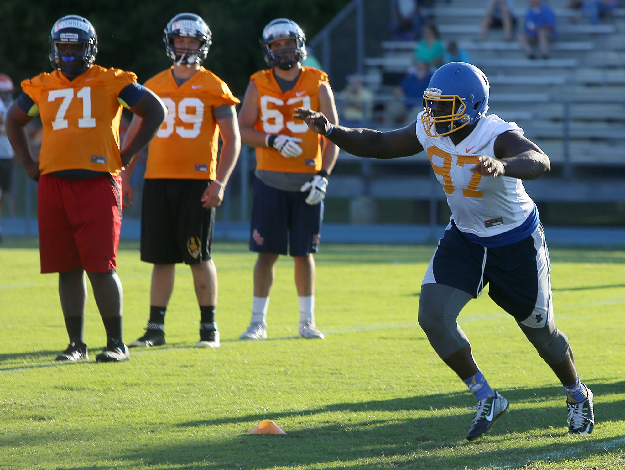 North Side High School defensive lineman Greg Emerson runs a drill during a University of Tennessee satellite lineman camp at University School of Jackson's Kirkland Field on Wednesday, June 8, 2016.