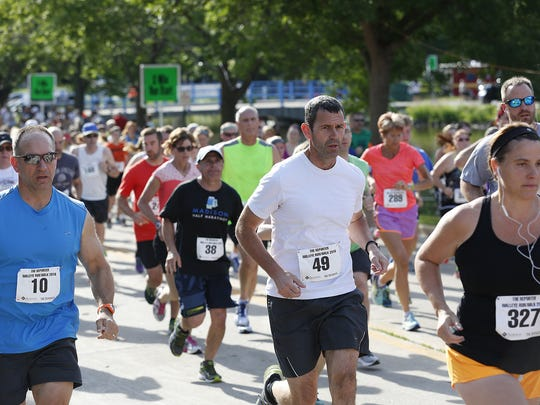 Runners take part in the Walleye Run/Walk Saturday at Walleye Weekend in Lakeside Park in Fond du Lac. The festival continues Sunday.