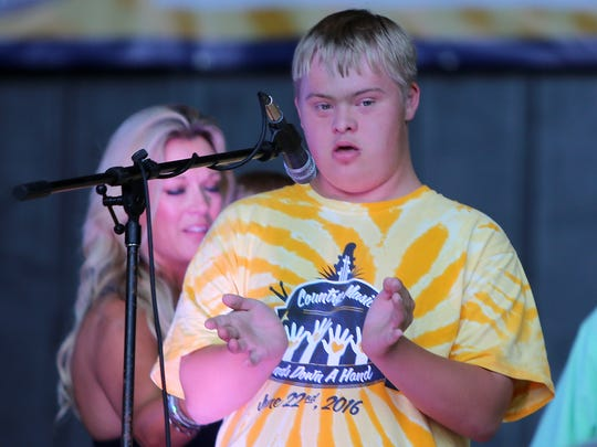 """Kevin Riffle performs """"We're All In This Together"""" during the fourth annual Country Music Lends Down a Hand concert at the Casey Jones Village Amphitheatre on Wednesday, June 22, 2016."""