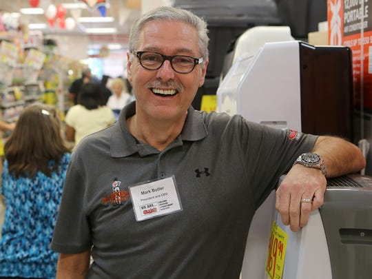 Ollie's Bargain Outlet President and CEO Mark Butler poses for a photograph during the grand opening of the store May 11 in Jackson.