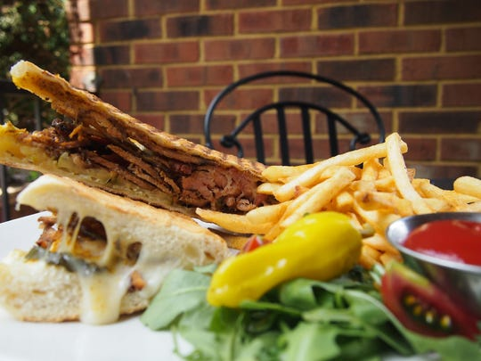 The Cuban Panini features chili-rubbed, house-smoked