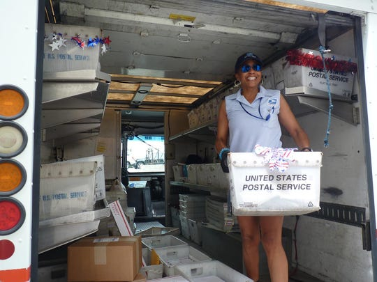 A U.S. Postal Service worker prepares to ship out letters