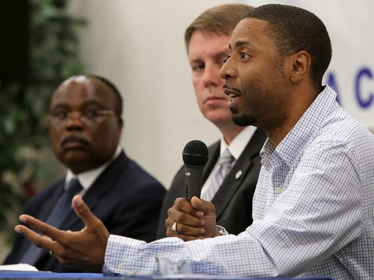 Jerome Cephus III speaks on a panel during a community meeting at the NAACP office downtown to discuss justice reform on Monday, July 11, 2016.