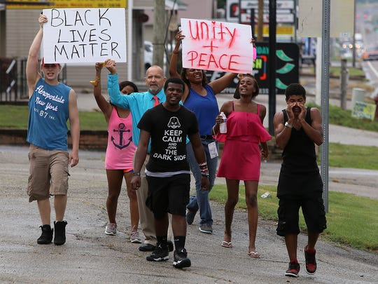 A group of Black Lives Matter protesters marches along U.S. 412 in Lexington, Tenn., on Tuesday, July 19, 2016.