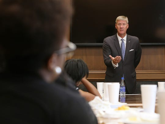 BancorpSouth President Doug Roth talks about cellphone etiquette during the Follow Me into Business luncheon at BancorpSouth downtown on Thursday, July 21, 2016.
