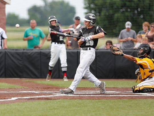 Waupun Post 210's Ryan Panten hits a pitch during a
