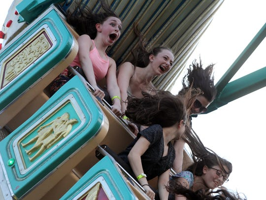 "Riders get a thrill on ""Pharaoh's Fury"" during night"