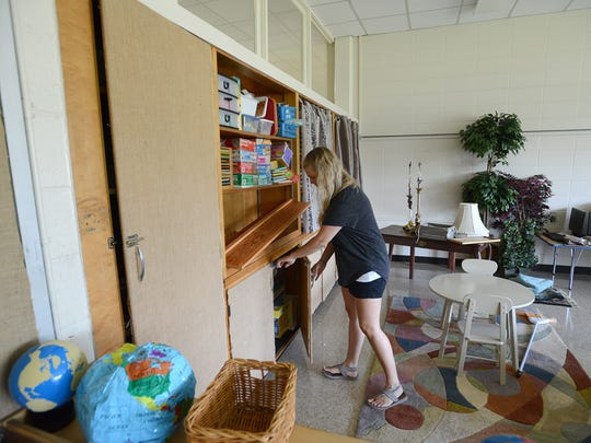 Rachel Turnbow works on getting her classroom ready for the first day of school at the Community Montessori School on Monday, July 25, 2016. Turnbow was a teacher at Malesus Elementary.