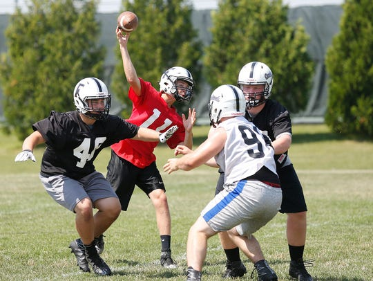 Fond du Lac High School's Jack Cole gets in some reps
