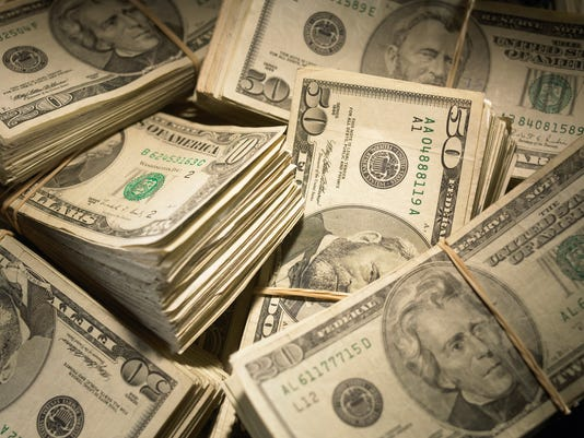 US Currency: Wads of US bills fastened with rubber bands, close-up