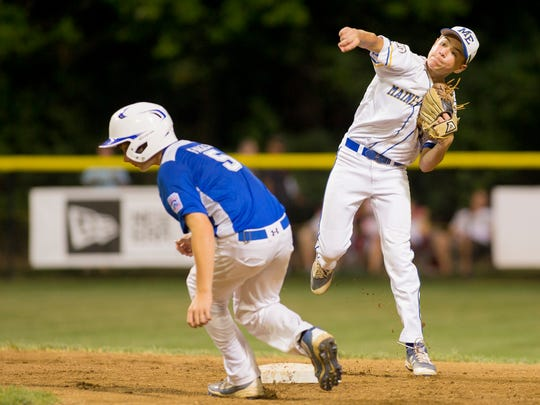 Pennsylvania's Kaden Falls is forced out at second as Maine-Endwell's Brody Raleigh throws to first during the third inning of Maine-Endwell's win Saturday evening in the MId-Atlantic Little League Championship game in Bristol Connecticut.