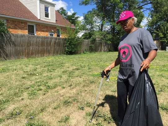 Lucy Farris, a member of Parklawn Assembly of God, helps with cleanup in Sherman Park neighborhood Sunday.