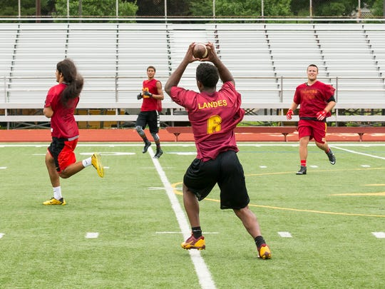 Nazier Landes makes the catch at the Ithaca High School football practice Monday morning.