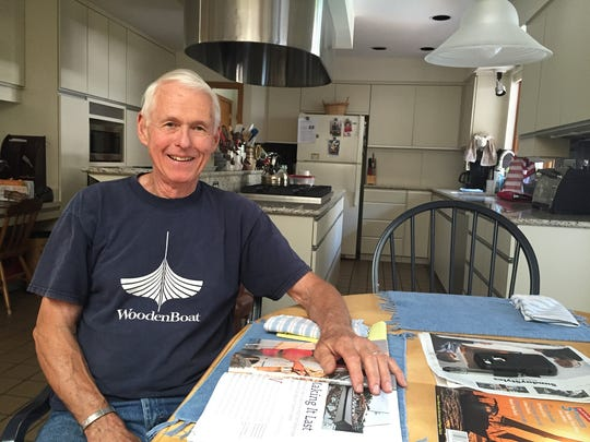 Bud Menchey talks about sailing in the dining room of his Spring Garden Township house. Sailing has been an obsession with him since he took it up three decades ago, so much so that he has taken time to learn to do everything to maintain his 30-year-old sailboat.