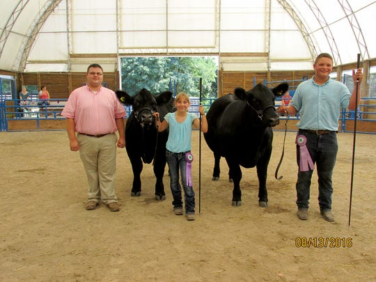 Karli Berkheimer (Mechanicsburg), center, exhibited the Grand Champion Prospect Steer. Samuel Parr (East Berlin), far right, exhibited the Reserve Steer. They are pictured with Judge, Troy Longenecker (Lebanon County).