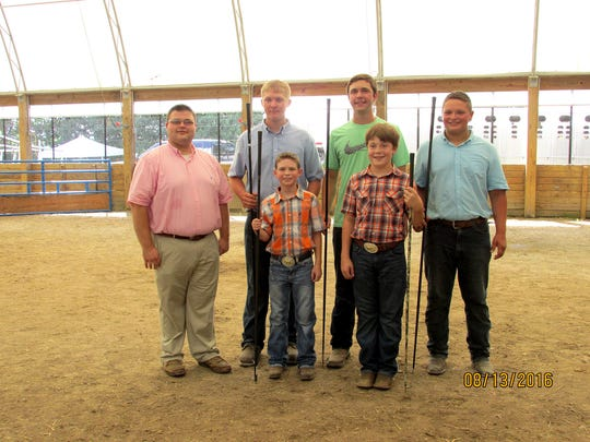 The following members were showmanship winners in their divisions, from left, front row: Conner Grim (Thomasville), Grant Fitzgerald (Seven Valleys); back row: Judge Troy Longenecker (Lebanon County), Dakota Mayle (Dillsburg), Grant Cash (York), and Samuel Parr (East Berlin).