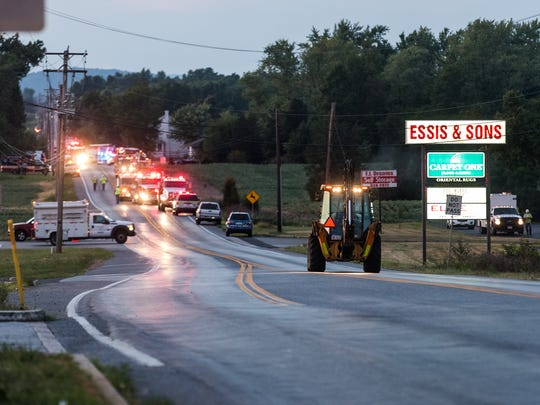 A backhoe from Columbia Gas drives towards the scene of a major gas leak on Aug. 25, 2016 in Hamilton Township, Adams County.
