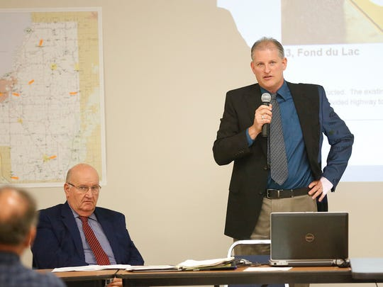 Fond du Lac County Executive Al Buechel listens as Fond du Lac County Highway Commissioner Tom Janke talks to Fond du Lac County residents about ongoing road problems and lack of state funding at a Turnout for Transportation meeting held Thursday at the Fond du Lac County Fairgrounds.