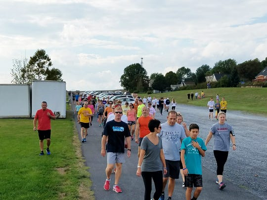 Friends, family and locals take part in a 5k run fundraiser at Norlo Park on Sunday, Oct. 2, 2016, for the Ataxia foundation. The event was put together by Madison Ford.