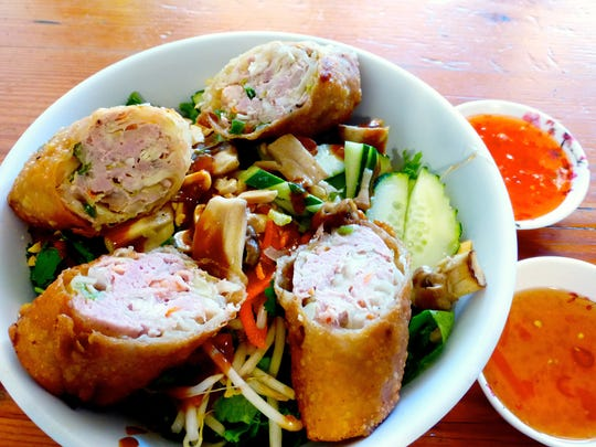 The bun cha gio is a noodle and vegetable bowl with two pork and shrimp fresh rolls served with house made sauces at Thuy's Noodle Shop.