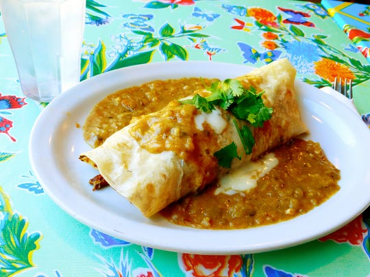 The smothered breakfast burrito at Ana's Seasonal Kitchen is stuffed with scrambled eggs, hash browns, onions, cheese, roasted Hatch chile and a smoky chorizo from a neighborhood market.