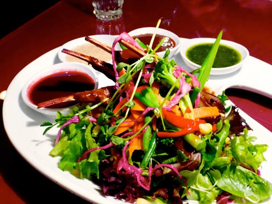 The grilled lamb salad is one of the entrees at Cafe Roka where every meal is served as a four course dinner.