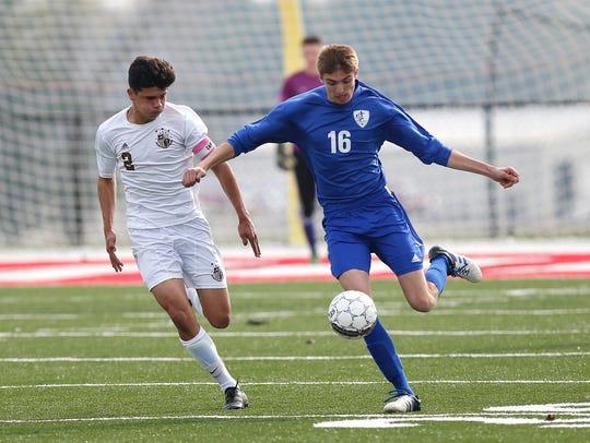 Winnebago Lutheran's Michael Bilitz kicks the ball