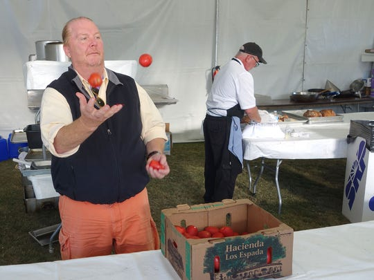 Mario Batali takes a moment to juggle tomatoes before