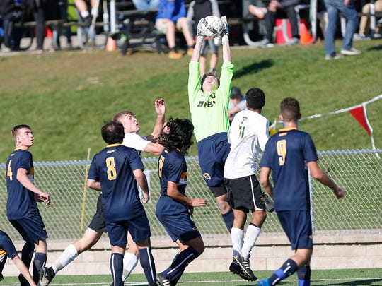Green Bay Preble High School's goal shot is blocked by Marquette University's goalie Joe Jochem in their WIAA Division 1 state championship game played at Uihlein Soccer Park in Milwaukee Saturday November 5, 2016. Marquette won the match up 1-0.  Doug Raflik/USA TODAY NETWORK-Wisconsin