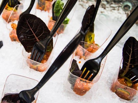 Fluke poke with pickled serrano, sesame and gem lettuce