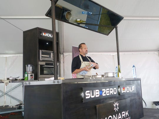 Chef Alex Stratta demos porcini risotto at the 2016