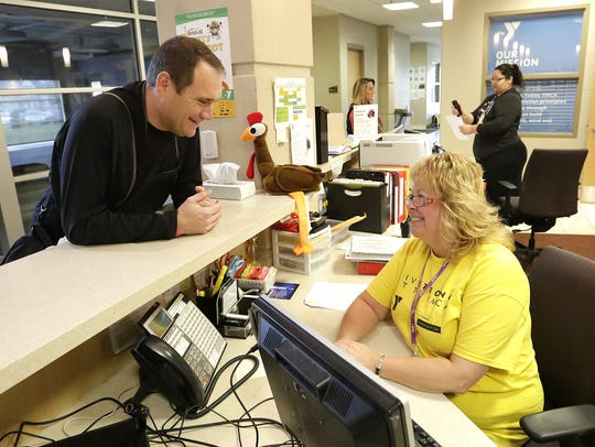 Rick Gilgenbach talks to YMCA employee Laura Giles