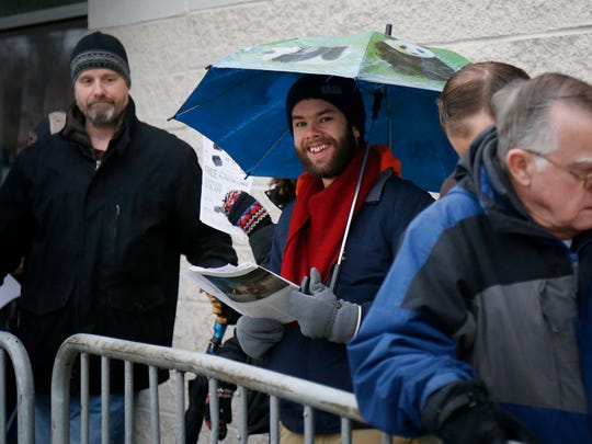 Customers line up outside Best Buy on late Thursday afternoon for their chance to nab a doorbuster deal on various item ahead of Black Friday. Some people waiting in line had to endure near freezing temperatures and rain.