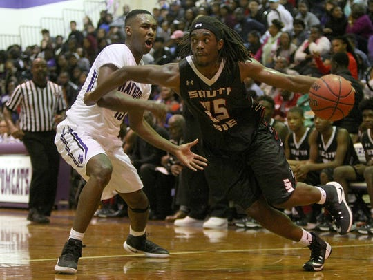 South Side's Geordan Reed (25) drives against Haywood's