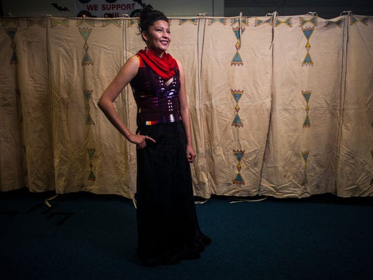 Autumn Boushie wears a design by Belinda Bullshoe accessorized