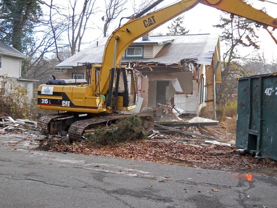 "A contractor hired by the borough of Totowa began to tear down four houses on Norwood Terrace and one on Riverview Drive in an effort to eventually clear out more houses that were damaged in Hurricane Irene of 2011, in a zone that floods repeatedly. The neighborhood long ago was dubbed ""Midgetville"" for its small houses."