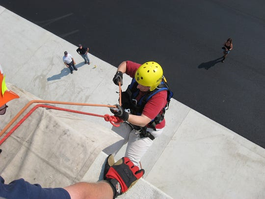 Barbara Fudge rapelling down a four-story building during a training exercise in Montour Falls in an undated photo. Fudge is a Erin Volunteer Fire Department firefighter.