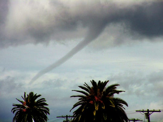 In this Feb. 22, 2005, file photo, a funnel cloud is seen over the Pacific Ocean off Venice Beach. The California coast creates an environment that allows tornadoes to form, due to cool air arriving from the Pacific Ocean and warm air coming from the inland deserts.