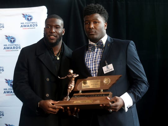 Titans football player Brian Orakpo, left, presents Emmit Gooden of Haywood the first-place Division I-Class 4A Lineman of the Year Award on Monday, Nov. 30, 2015, during the 2015 Tennessee Titans Mr. Football Awards ceremony at Nissan Stadium.