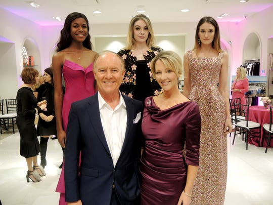Mark Humphreys and Emily Hastings with Brittany Jenkins, back left, Taylor Boswell and Sammi Moore modeling Zac Posen fashions at the Symphony Fashion Show Launch Party, held at Gus Mayer.