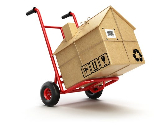 Delivery or moving houseconcept. Hand truck with cardboard