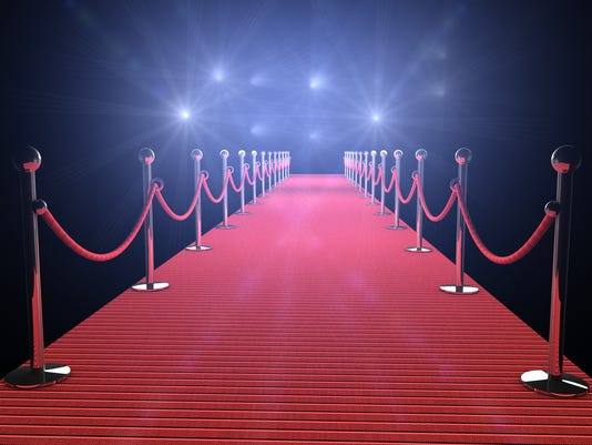 Illuminated red carpet with flashing lights and black walls