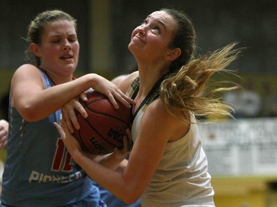 Dresden's Kasey Gallimore, right, tries to keep the