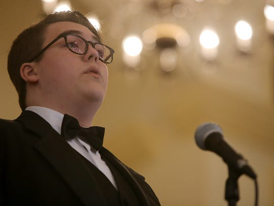 """Riley Hooper solos during """"Tell My Father"""" with the Madison Men during the Jackson Choral Festival at the R.E. Womack Memorial Chapel on the campus of the University of Memphis Lambuth in Jackson on Thursday, March 2, 2017."""