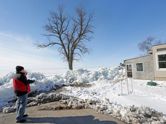 Steve Frane of Sherwood flies his drone over an ice shove north of Stockbridge on the east side of Lake Winnebago that damaged two cottages and several boathouses. Friday March 3, 2017.