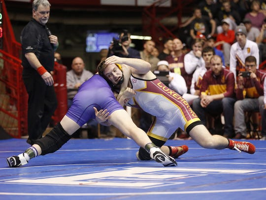 Luxemburg-Casco High School wrestler Kyle Routhieaux wrestles Cole Toenjes of Ellsworth in the 195-pound weight division during the Division 2 WIAA state championship match in Madison Saturday March 4, 2017.