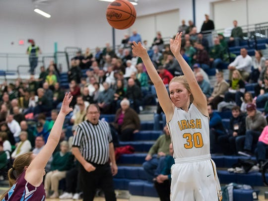 York Catholic's Katy Rader (30) attempts a 3-point shot during the first-round tournament match-up of the PIAA Class 3A between York Catholic and Loyalsock on Saturday, March 11, 2017 at West York High School.